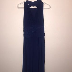Blue sleeveless dress.